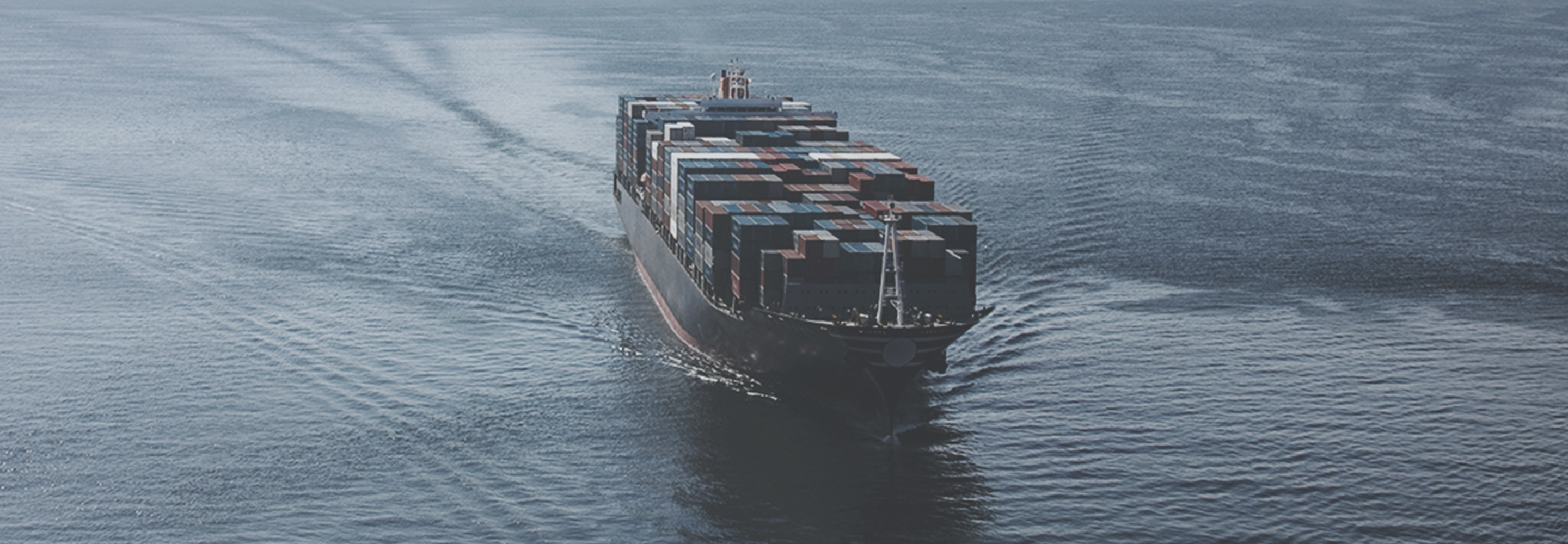 Ship sailing the ocean carrying shipping containers