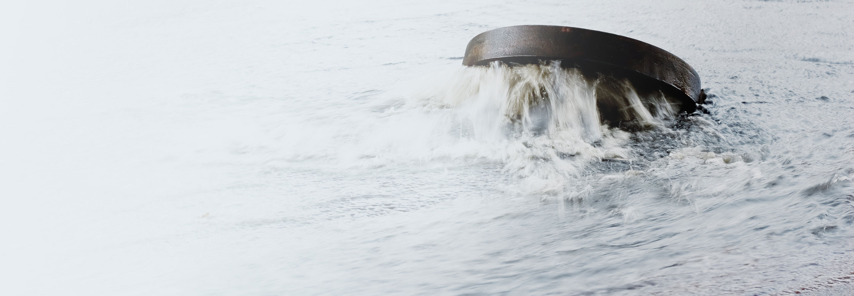 sewage-lid-open-with-rushing-water-around