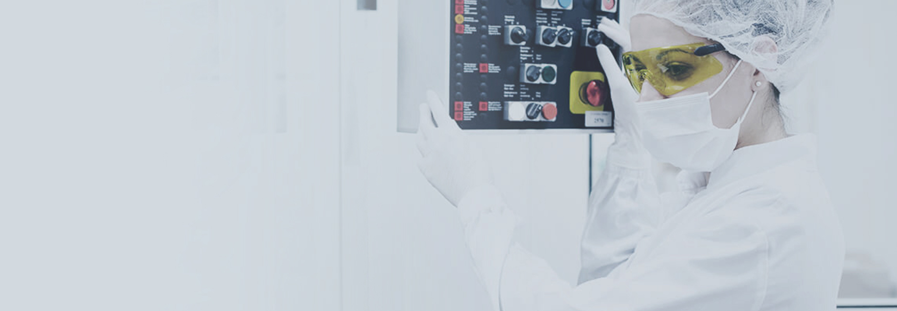 Woman in protective equipment at control panel