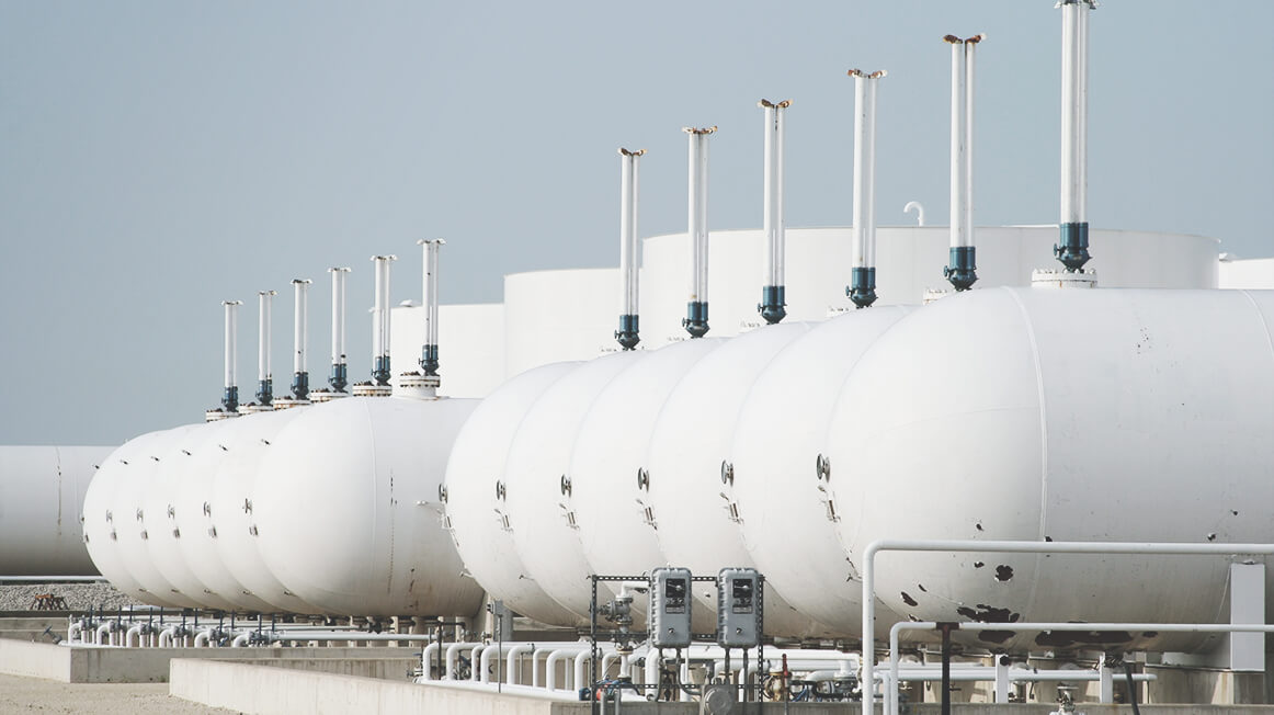 row of outdoor chemical storage tanks