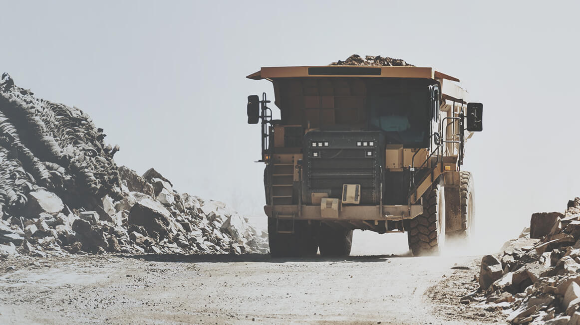 metals and mining dump truck carrying rubble