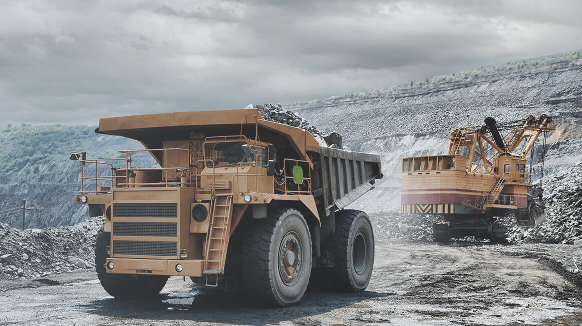 dump truck and excavator at mine site for remote operations monitoring