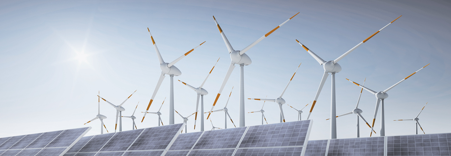 wind mills and solar panels in the sun
