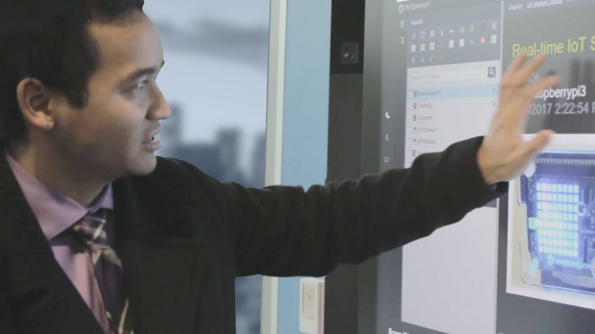 person touching computer screen using pi system