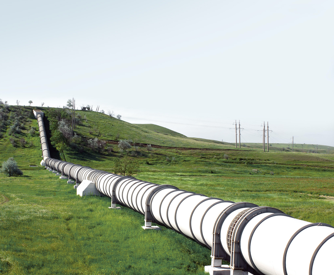 large pipe across a green grassy field