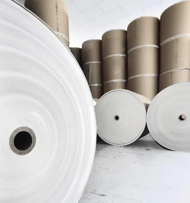 Stacked rolls of large paper